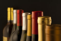 Wine bottle necks. With limited depth of field on black stock images