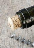 Wine bottle and opener Stock Photography