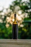 Wine Bottle on Porch Railing at Sunset Stock Photos