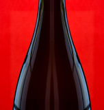 Wine Bottle on Red Royalty Free Stock Photos