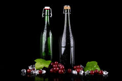 Wine bottle with red grape Royalty Free Stock Images