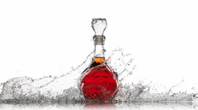 Wine. Bottle of red wine with water splash on white background Stock Image