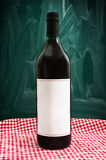 Wine bottle on a restaurant table Royalty Free Stock Image