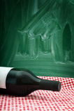 Wine bottle on a restaurant table Royalty Free Stock Photos