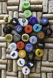 Wine Bottle Screw Caps on top of corks Royalty Free Stock Photos