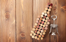 Wine bottle shaped corks and corkscrew Stock Photo