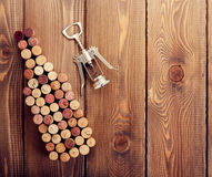 Wine bottle shaped corks and corkscrew Royalty Free Stock Photos