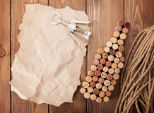 Wine bottle shaped corks, corkscrew and piece of paper for copy Stock Image