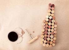 Wine bottle shaped corks, glass of wine and corkscrew Royalty Free Stock Photography
