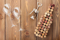 Wine bottle shaped corks, glasses and corkscrew Royalty Free Stock Images