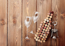 Wine bottle shaped corks, glasses and corkscrew Stock Images