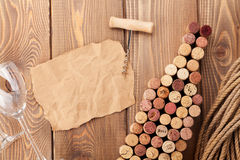 Wine bottle shaped corks, wine glass and corkscrew Royalty Free Stock Photos