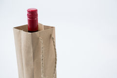 Wine bottle in shopping bag Royalty Free Stock Image