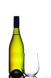 Wine bottle and stemless glass. A bottle of white wine and a stemless glass isolated on white royalty free stock photography