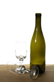 WIne bottle on a table with glasses Stock Photography