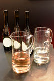 Wine bottle. Three bottles of rose wine and a glass of wine Royalty Free Stock Images