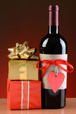 Wine Bottle and Valentines Presents Stock Photo