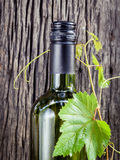 Wine bottle with vine and wine cork. Put on the board Royalty Free Stock Photo
