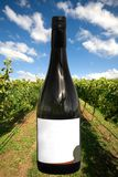 A Wine Bottle with a Vineyard Scene Stock Photography