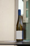 Wine bottle with a white label Royalty Free Stock Image