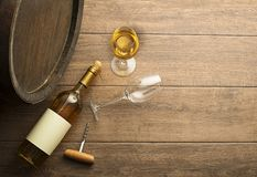 Wine bootle and glass on wooden table stock photos