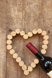 Wine bottle and wine cork heart Stock Photos