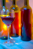 Wine bottle and wine glass. Royalty Free Stock Images