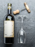 Wine bottle, wine glass and corkscrew. Royalty Free Stock Images