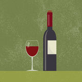 Wine bottle and wine glass. Stock Photos