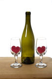 Wine bottle and wine glasses with hearts Stock Image