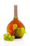 Wine bottle with wine grapes and grape leaves. Royalty Free Stock Photos