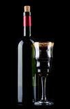 Wine bottle and wineglass Stock Images