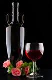 Wine bottle and wineglass on black background Stock Image