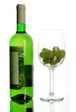 Wine bottle and wineglass with grape Stock Image
