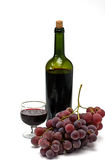 Wine bottle and wineglass with grape Stock Images