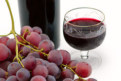 Wine bottle and wineglass with grape isolated Stock Images