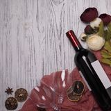 Wine bottle wineglass peonys on white wooden table. Wine bottle wineglass peonys on white wooden table Stock Photography