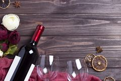 Wine bottle wineglass peonys on white wooden table. Wine bottle wineglass peonys on white wooden table Royalty Free Stock Photography