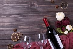 Wine bottle wineglass peonys on white wooden table. Wine bottle wineglass peonys on white wooden table Royalty Free Stock Image