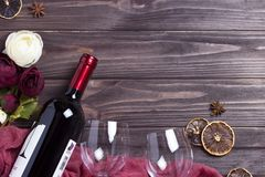 Wine bottle wineglass peonys on wooden table. Wine bottle wineglass peonys on wooden table Stock Photography