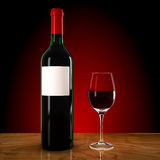 Wine bottle and wineglass Royalty Free Stock Image