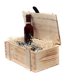 Wine bottle in wooden case Stock Photo
