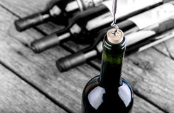 Wine bottle on a wooden table Royalty Free Stock Photo