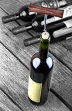 Wine bottle on a wooden table Royalty Free Stock Photos