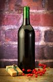 Wine bottle with wrapped box Royalty Free Stock Photos