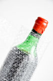 Wine bottle wrapped in bubble air foil Stock Photography
