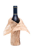 Wine bottle with wrapping paper. Isolated on white background Stock Images