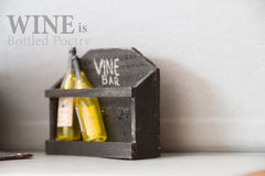 Wine is Bottled Poetry. Wine Bar, written in chalk and bottles royalty free stock photography
