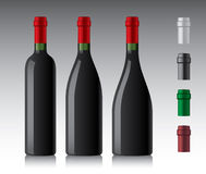 Wine bottles. Three different red wine bottles Royalty Free Stock Photos