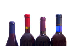 Wine bottles. Four different colorful wine bottles isolated over white background Royalty Free Stock Photo